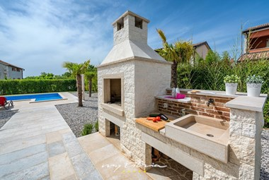 Large fireplace for al fresco dining during your villa holiday