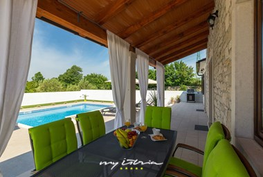 Outside dining area in villa in Istria