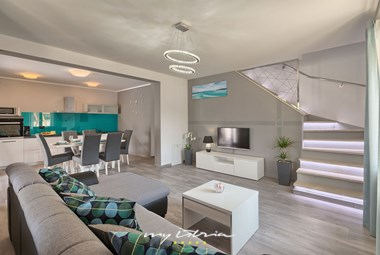Modern living room in villa with pool in Istria