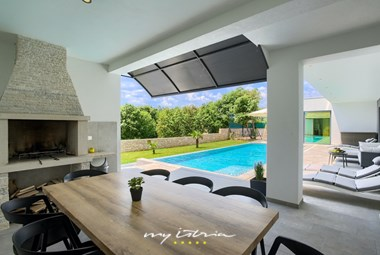 Great terrace with dining area and fireplace in Villa Stokovci II