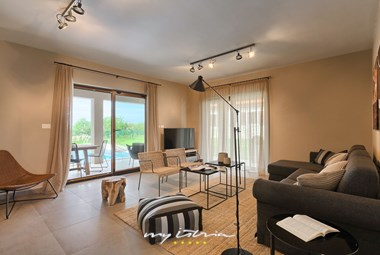 Modern living room with access to villa´s garden and pool