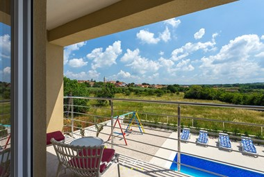View of the pool are and beautiful surroundings  from the terrace of Villa Renata