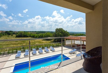 View over the pool area and surroundings in Villa Renata