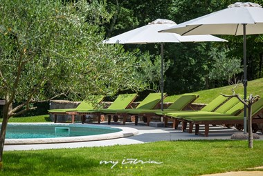Relax on the sun lounger by the private pool  in Villa Maccaroni