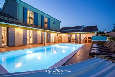 Beautiful villa Mek with sun loungers and private pool at night