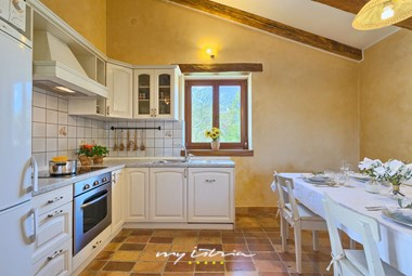 Villa´s fully equipped kitchen with dining area