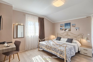 Stylish bedroom with double bed in Villa Murva