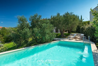 The private pool of this wonderful villa is surrounded by olive groves