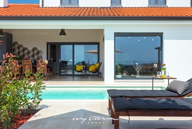 Enjoy the sun on the pool area in front of the villa