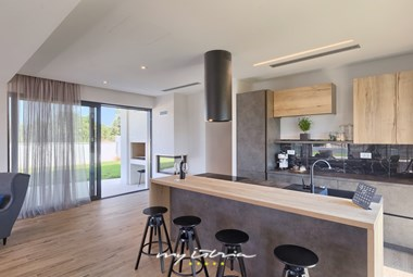 Elegant kitchen with balcony doors in Villa Gabi