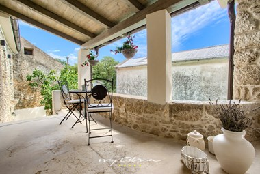Lovely stone balcony overlooking villa´s pool