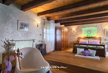 Rustic bedroom with double bed in Villa Edi
