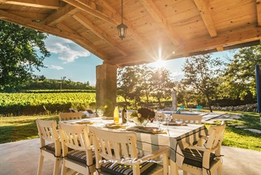 Romantic covered outdoor dining area in the fantastic Villa Kanedolo