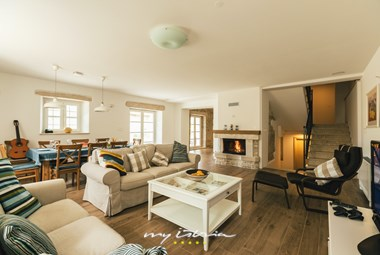 Cosy living area with fireplace in Villa Kanedolo