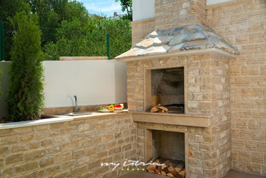Fireplace for preparing meals outside the villa