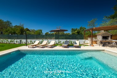Inviting sun loungers at the private pool