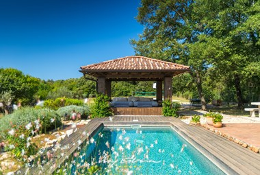 Private pool in the large garden of the villa