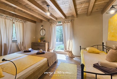 Lovely bedroom with double and single bed and access to villa´s garden