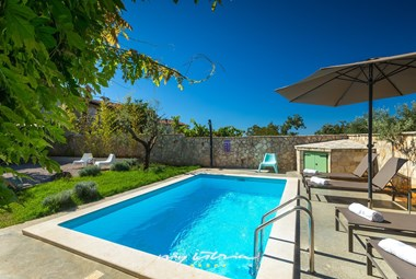 Soak up the sun by the private pool