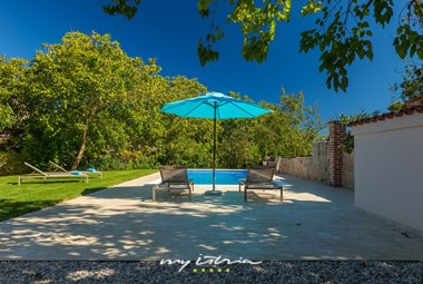 Private pool in villa´s tended garden