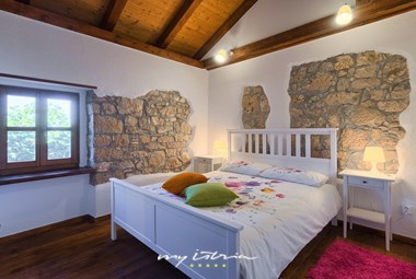 Bedroom with double bed in the villa