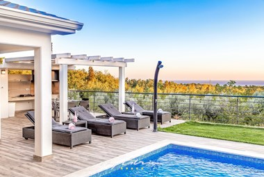 Relax on the comfy sun loungers and enjoy the sea view in this beautiful villa in Labin