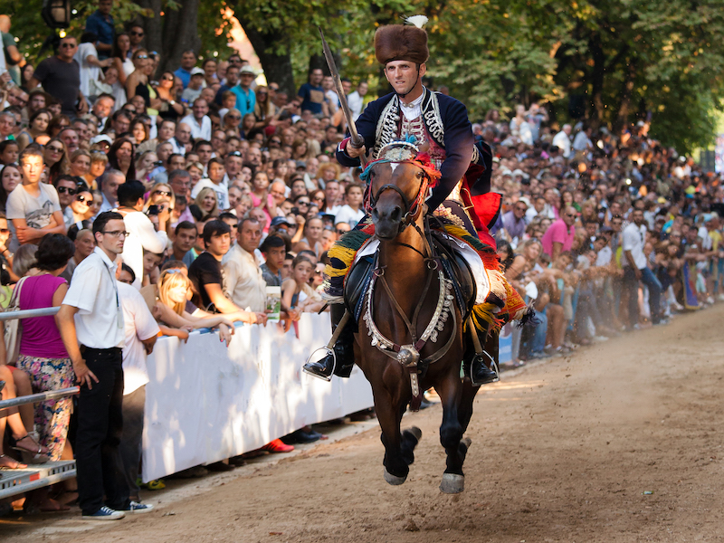 "A full-galloping Alkar in the ""hunt for the Alka ring"" during Sinjska alka"