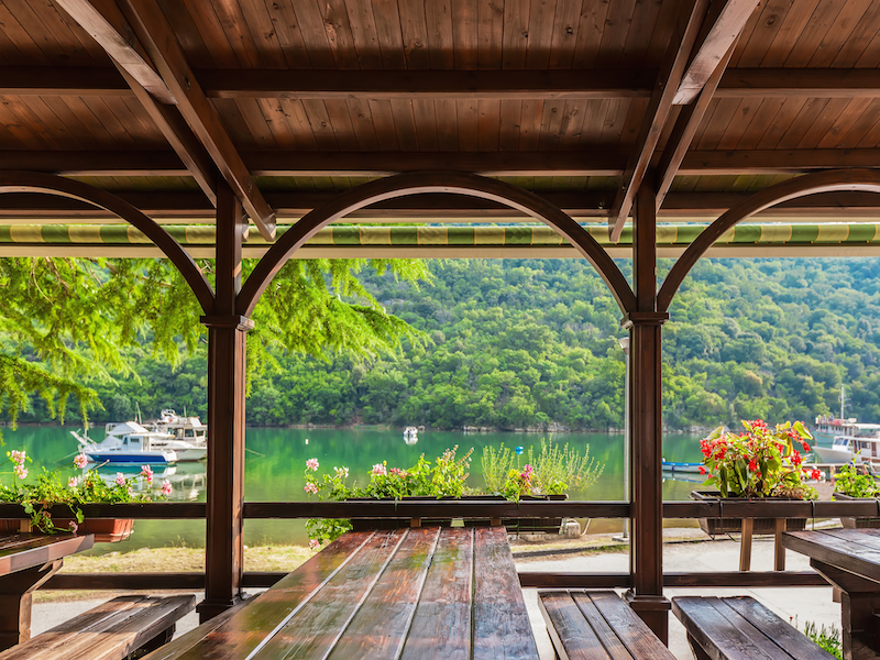 view-from-a-wooden-terrace-with-flowers-at-the-boats-and-Lim-Bay-in-Istria