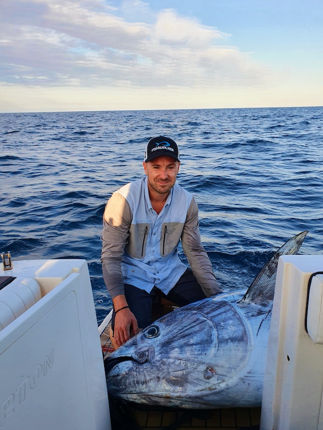 owner-of-efishent-Nikola-Mijandrusic-on-a-boat-with-a-large.freshly-caught-fish-in-front-of-him