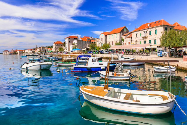 small-wooden-boats-in-the-harbour-of.Kastel-Stari-with-view-of-the-city