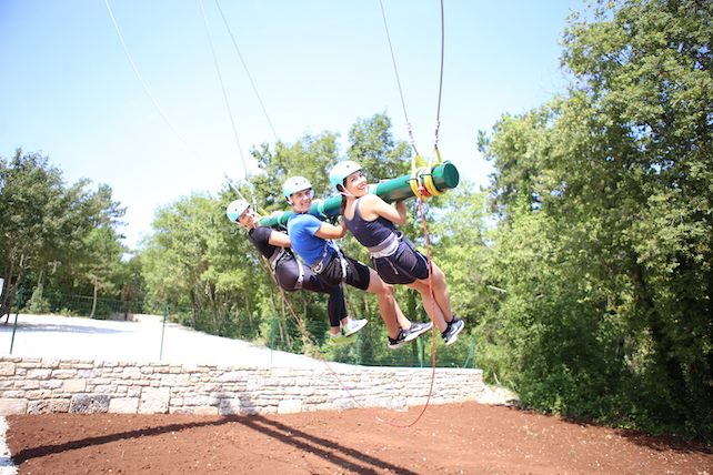 three-persons-hanging-from-a-swing-smiling-in-Kringa-adventure-park