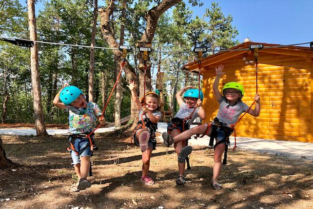 four-small-children-tied-with-safety-ropes-having-fun-in-Kringa-adventure-park
