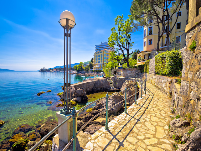 part-of-Lungomare-promenade-in-Opatija-with-sea-to-the-left-houses-to-the-right