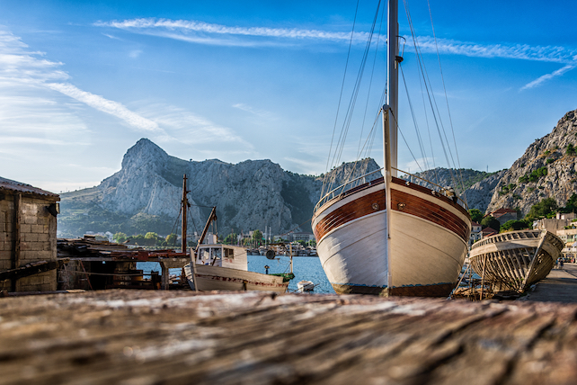 view-of-a-larger-ship-and-a-couple-of-smaller-boats-in-omis-harbour