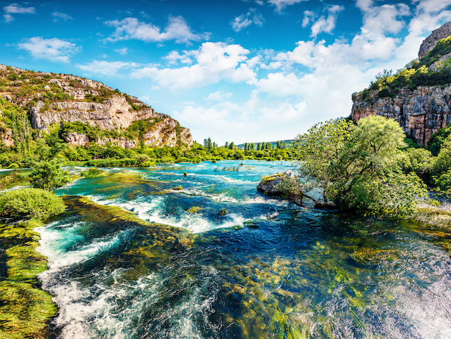 Small-waterfalls-on-the-river-Krka-surrounded-by-hills-from-both-sides