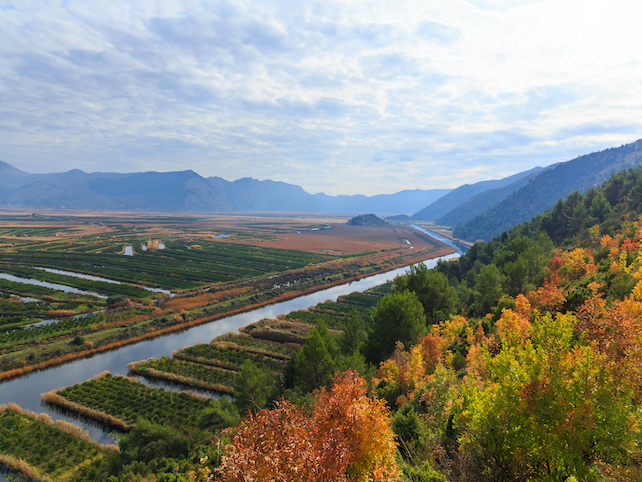 river-Neretva-during-autumn-surrounded-by-many-fields-and agricultural-land