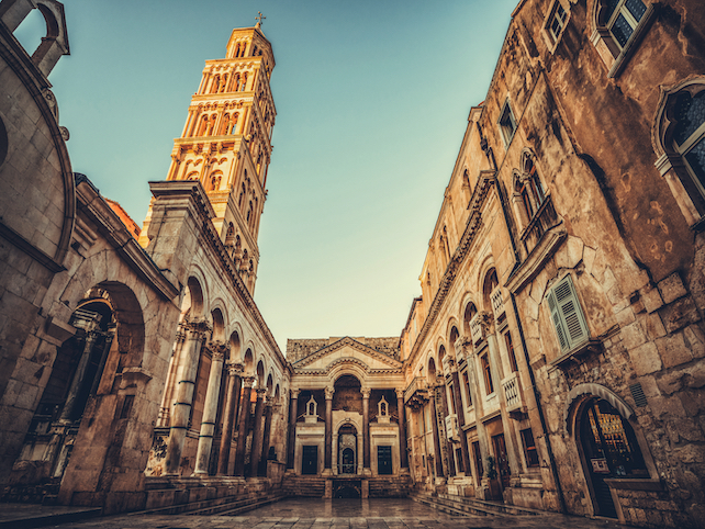 walls-and-square-withtin-the-ancient-Diocletian-palace-located-in-Split-during-sunset