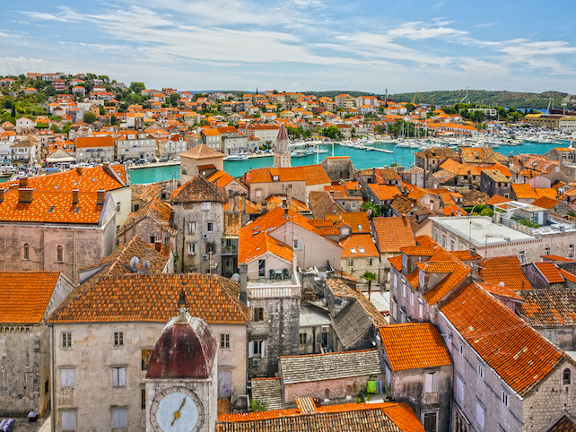 ancient-town-of-trogir-surrounded-by-sea-in-Dalmatia-with-many-old-houses-and-monuments