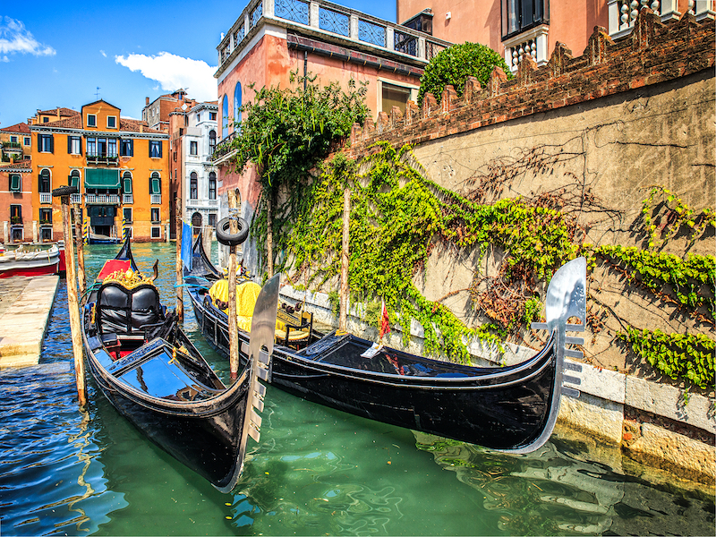 decorated-empty-gondolas-left-in-one-of-the-channels-in-Venice-Italy