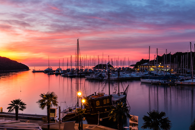 view-from-Vrsar-of-the-town-harbour-with-stunning-red-and-orange-colours-in-the-sky